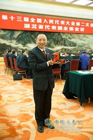 全国人大代表、东风商用车有限公司车辆工厂调检一车间班长王建清
