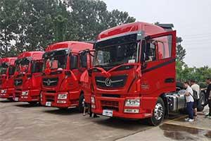 可靠的车交给可靠的用户  5台国六600马力东风天龙旗舰交付洛阳FS物流